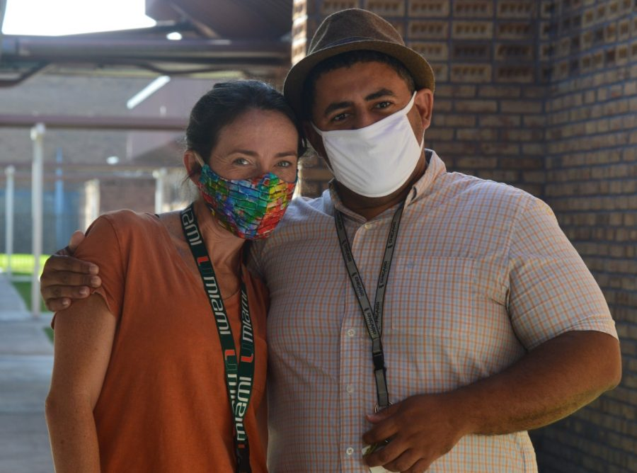 Mr. Fernando, in his famous Fedora, poses with Ms. Sintov in their masks..