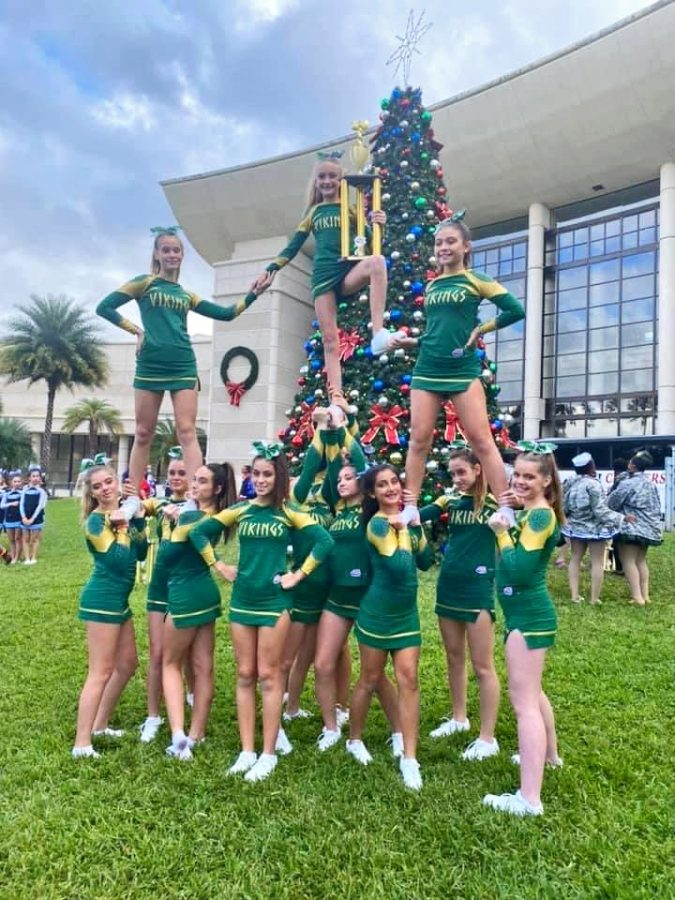 The+Venice+Viking+Cheerleaders+show+off+their+trophy+at+Nationals.++