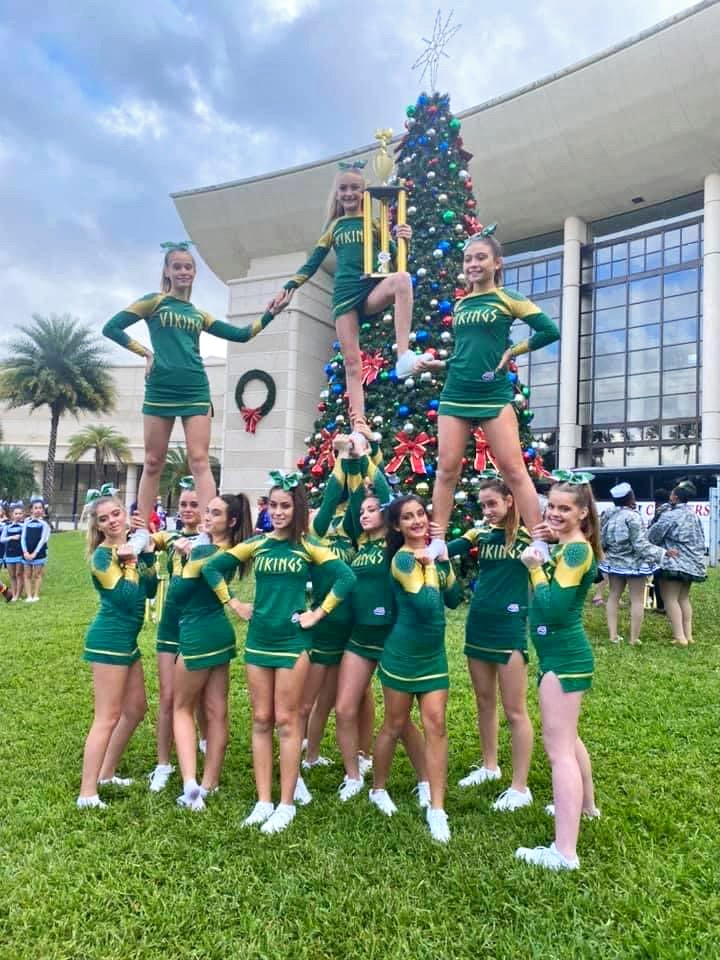 The Venice Viking Cheerleaders show off their trophy at Nationals.